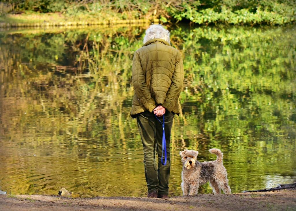 dog and woman at water